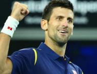 Tennis: Djokovic holds off Dimitrov to reach Paris quarters