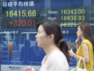 Asia markets build on gains after Wall Street record
