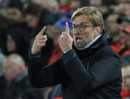 Football: Klopp wants players to strike right balance