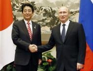 Putin, Abe to hold hot spring meet on WWII island row