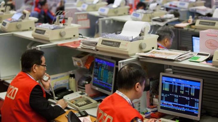 Hong Kong, Shanghai close up in first trade of year