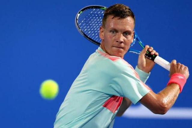 Tsonga through after second set scare in Doha