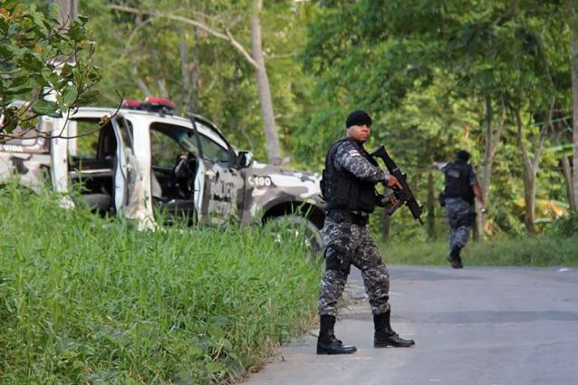 Brazil hunts escaped inmates after bloody prison riot