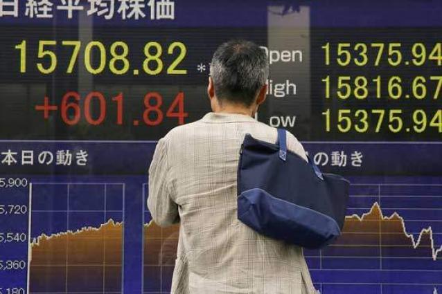 Tokyo shares jump higher on weaker yen