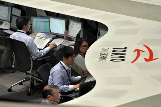 Tokyo shares drift in morning