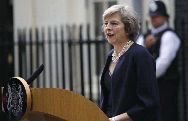May defends Pounds 300 mln aid for Pakistan