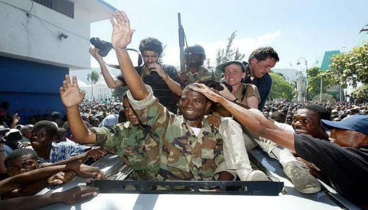 Former Haiti coup leader, wanted in US, arrested