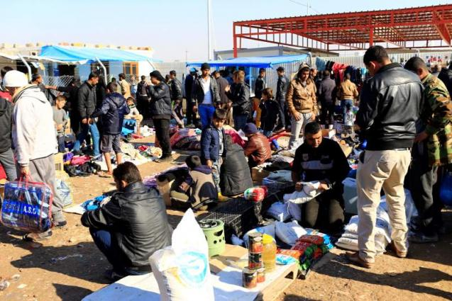 For Mosul displaced, shelter is often just down the road
