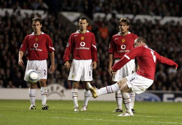 Football: Rooney equals record as Man Utd sink Reading