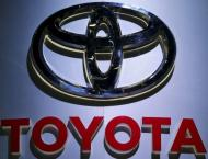 Toyota 9-month net profit falls but hikes annual outlook