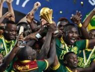 Football: Cameroon toast unlikely triumph and look to future
