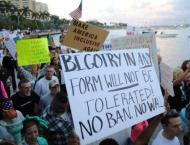 At least 2,000 march on Trump's Florida resort