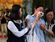 Distraught relatives mourn victims of Taiwan bus crash