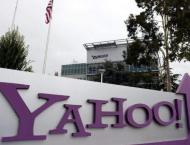 Yahoo price slashed as Verizon proceeds with buy