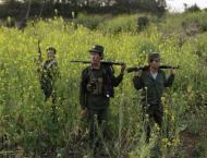 Thousands flee Myanmar border town after rebel raid