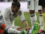 Bale limps off in Clasico return