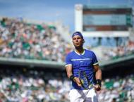Tennis: Nadal, Djokovic march on as Muguruza survives
