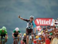 Cycling: Aru takes yellow as Bardet wins Tour 12th stage