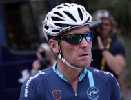 Disgraced Armstrong back on Tour de France -- as commentator