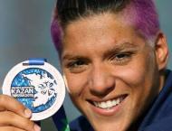 Swimming: Brazil's Cunha defends open-water marathon crown