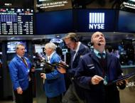 Strong earnings lift Dow, but Nasdaq hit by Alphabet