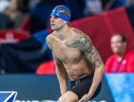 Swimming: Dressel wins men's 100m butterfly world title
