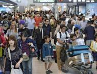 Japan Airlines logs quarterly profit gain, upgrades outlook