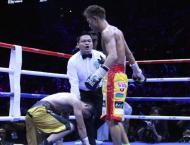 Boxing: Beaten Zou vows to win back world title