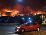 Hundreds flee as fire rages in southern France