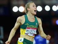 Athletics: Aussie great Pearson eases into 100m hurdles semis
