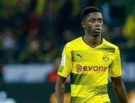 Football: Dortmund stand ground with Barca-target Dembele
