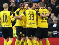 Football: Dortmund held by 10-man Freiburg as Spurs loom