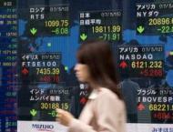 Tokyo stocks end slightly higher despite upbeat business report