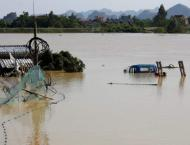 Vietnam braces for more downpours as flood toll hits 72