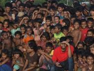 Clowns bring laughter to traumatised Rohingya children