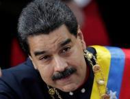 Venezuela in 'selective default', signs debt deal with Russia