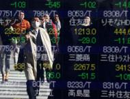 Asian markets head for positive end to volatile week