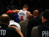 NBA: Knicks snap skid despite Porzingis injury scare