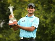 Golf: Sharma wins South African event he nearly missed