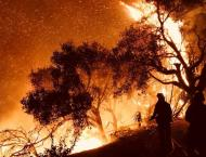 Biggest LA fire spreading more slowly as survivors pick up the pi ..