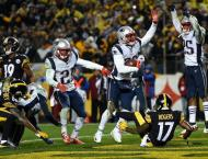 NFL: Pats clinch division with wild win over Steelers