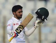 Ton-up Mominul powers Bangladesh to 374-4 on day one