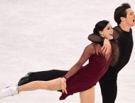 Games face new doping case as Canadian skaters serve up magic