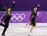 Games face new doping blow as Canadian skaters serve up magic