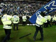 Wigan to probe crowd trouble after Man City FA Cup shock