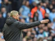 Wenger tightlipped on Arsenal future