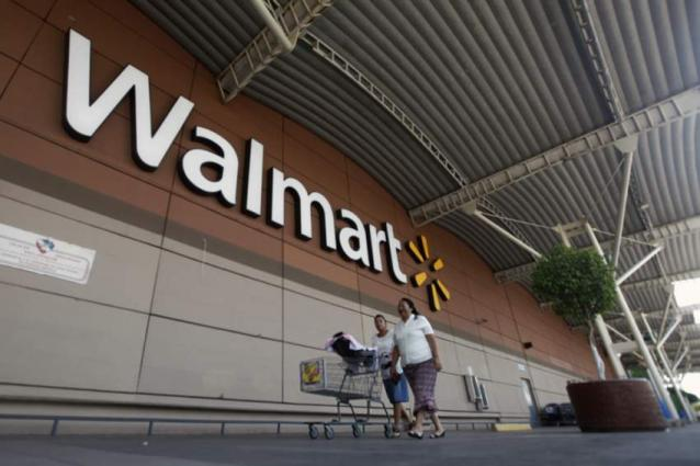 Walmart profit drops, online sales growth slows in Christmas quarter