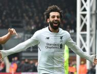 Salah strikes again to move Liverpool into second