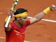 'Day to remember' as record-setting Rafa returns in style