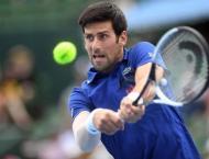 Djokovic battles past Coric to reach third round